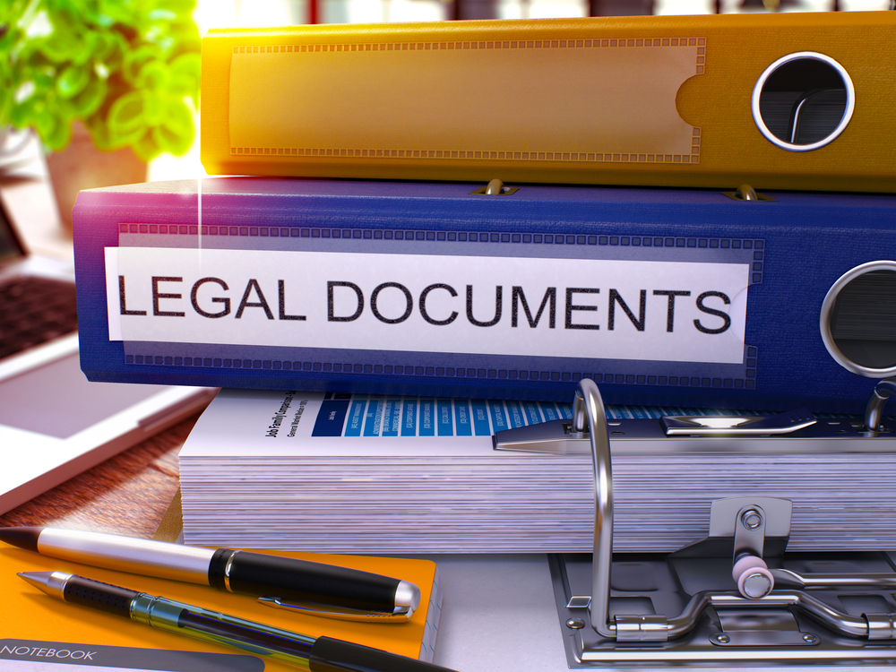 Blue Office Folder with Inscription Legal Documents on Office Desktop with Office Supplies and Modern Laptop. Legal Documents Business Concept on Blurred Background. Legal Documents - Toned Image. 3D